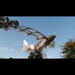 Majestic III Stainless Steel, Bronze & iridized glass flying fish sculpture. 8'x6'x7'